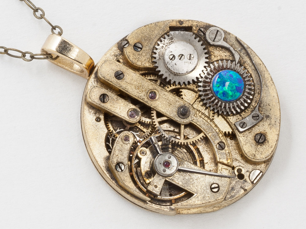 black opal and gold pocket watch necklace with steel gears