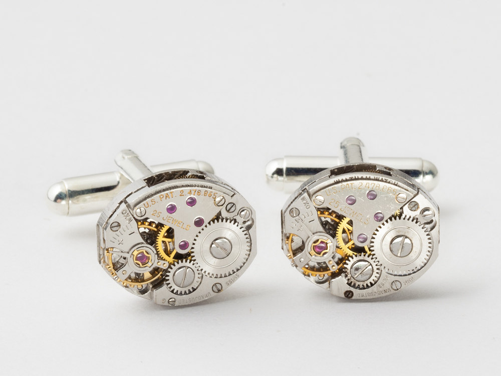 Steampunk cufflinks made with watch movements with gears and ruby