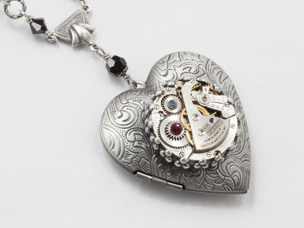 Steampunk jewelry featuring a heart shaped locket embellished with a steampunk jewelry steampunk necklace heart locket watch movement gears black red garnet crystal silver leaf pendant aloadofball Image collections