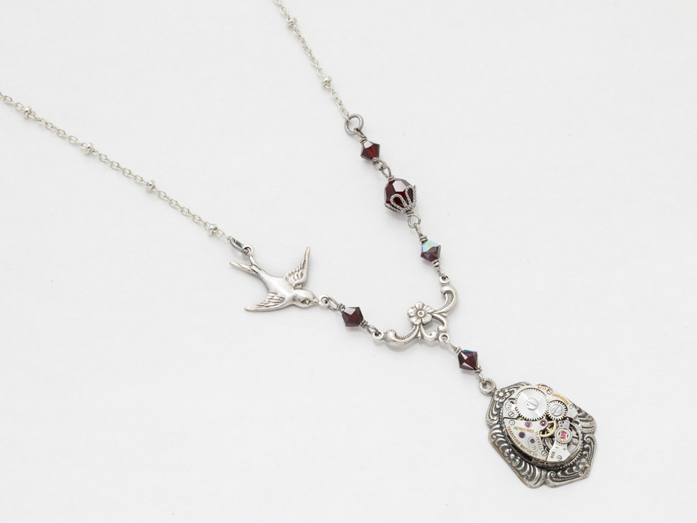 Steampunk necklace made with a watch movement silver bird floral steampunk jewelry steampunk necklace watch movement gear silver bird flower leaf filigree garnet red crystal statement mozeypictures Image collections