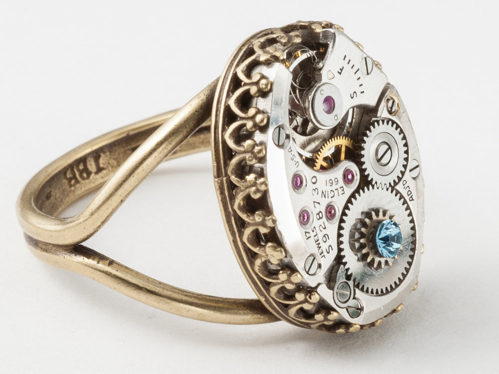 Steampunk Ring made from a watch movement gears blue aquamarine