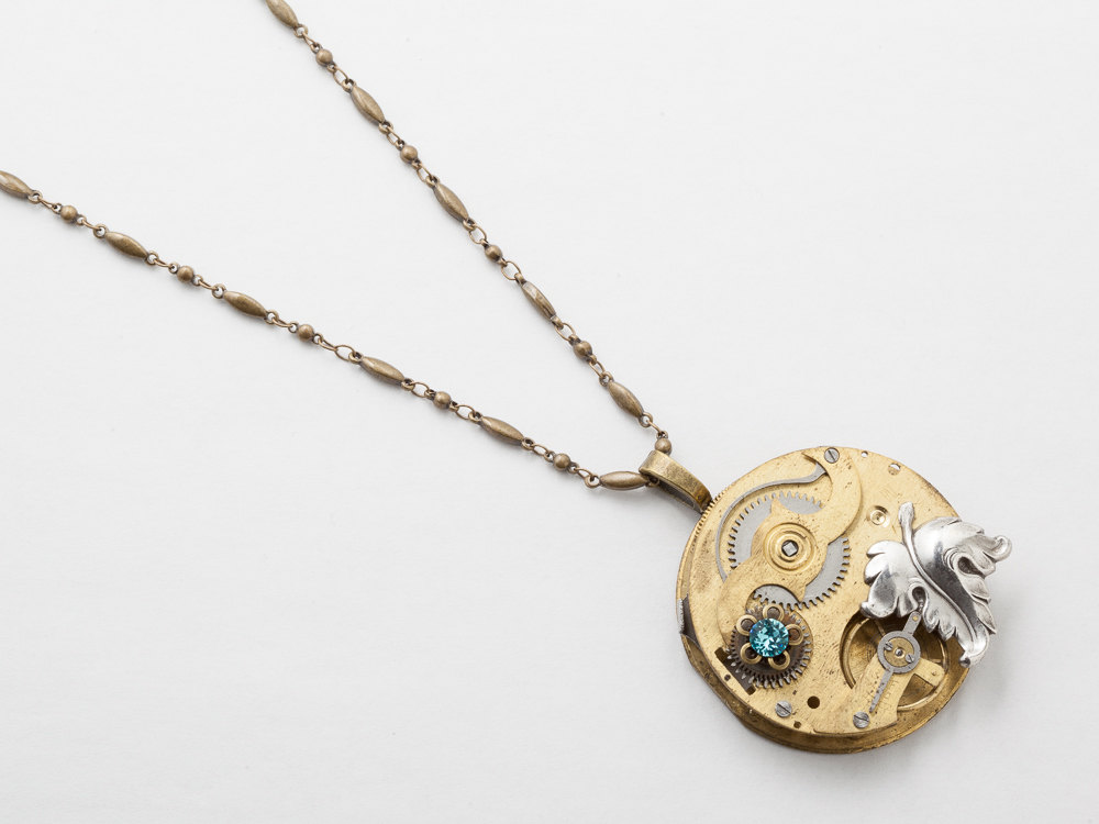 Steampunk Necklace gold pocket watch movement with blue crystal flower pendant silver leaf statement necklace Steampunk jewelry