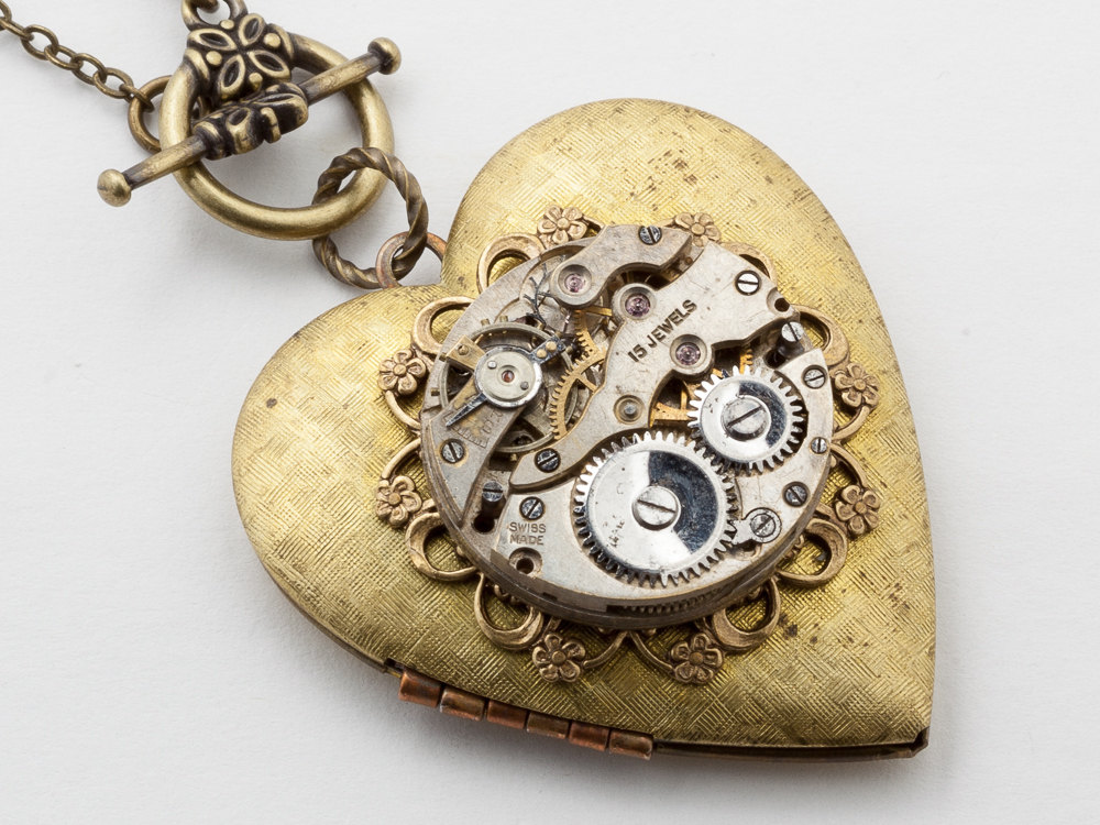 Steampunk heart shaped necklace made with a watch movement and steampunk necklace heart locket watch movement gears gold leaf filigree flower pendant steampunk jewelry aloadofball Image collections