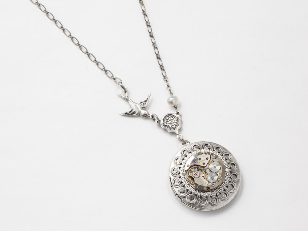 Steampunk jewelry a necklace with locket embellished with a watch steampunk necklace locket watch movement gears pearl filigree leaf silver bird charm steampunk jewelry statement pendant aloadofball Choice Image