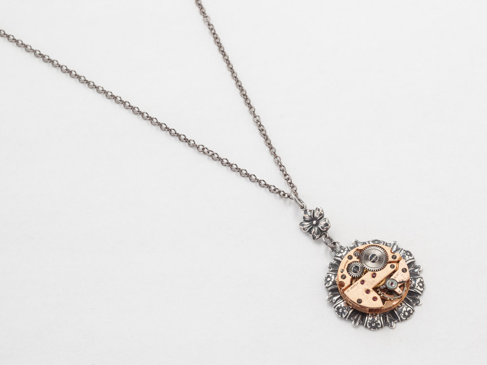 Steampunk silver flower necklace with a rose gold watch movement