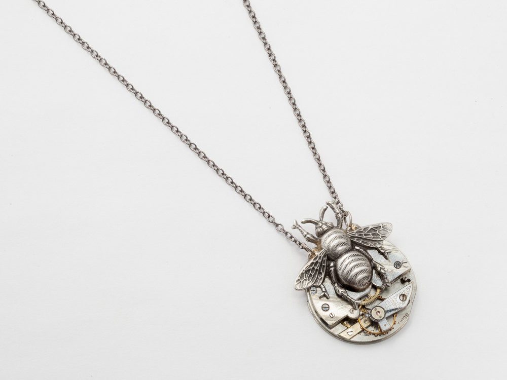 Steampunk necklace made from a pocket watch movement and a silver steampunk necklace pocket watch movement gears silver bumble bee pendant steampunk jewelry statement necklace aloadofball Images