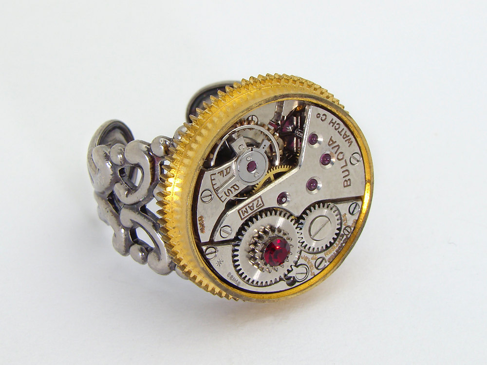 steampunk ring watch movement gold gear garnet red crystal